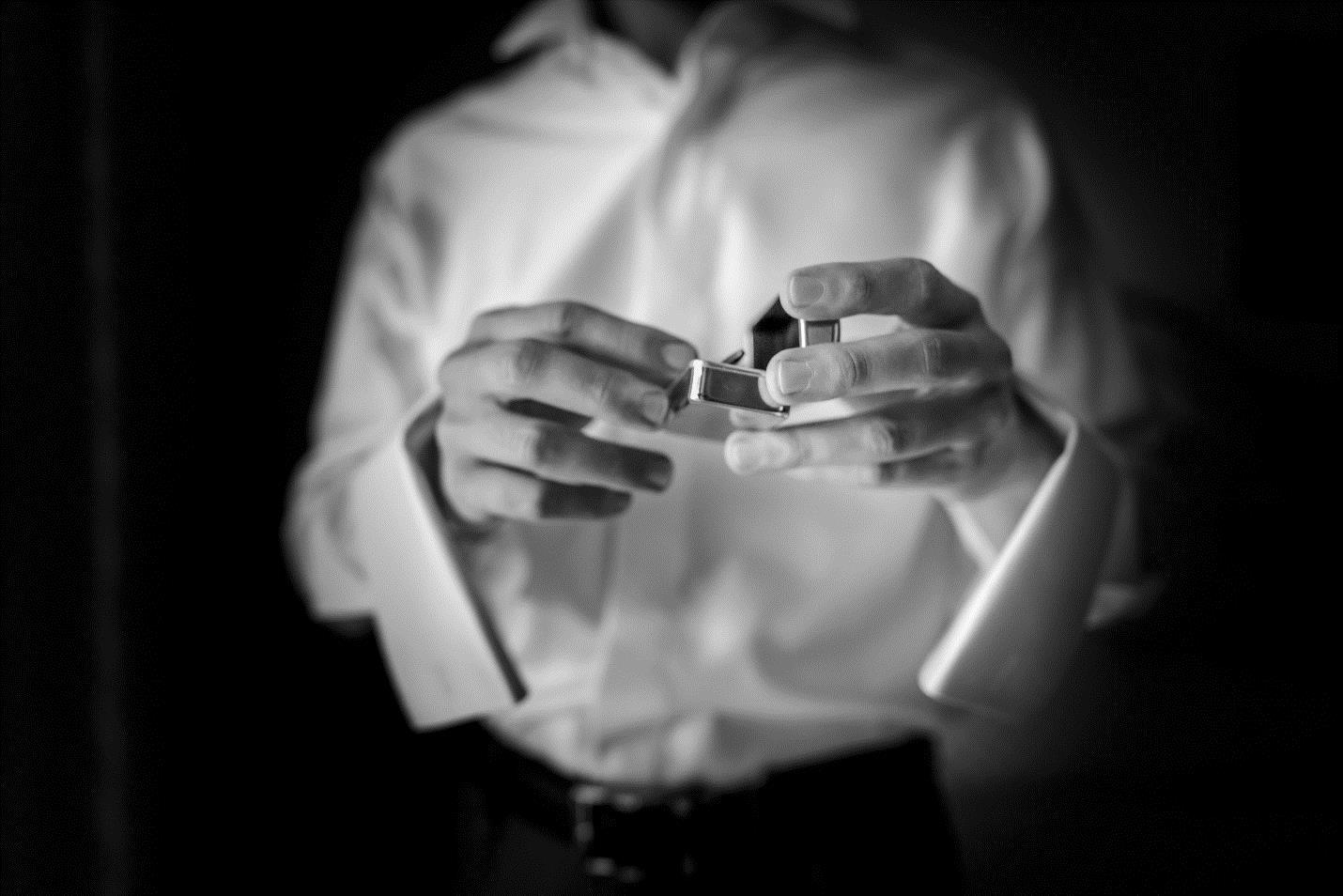 man holding wedding ring box