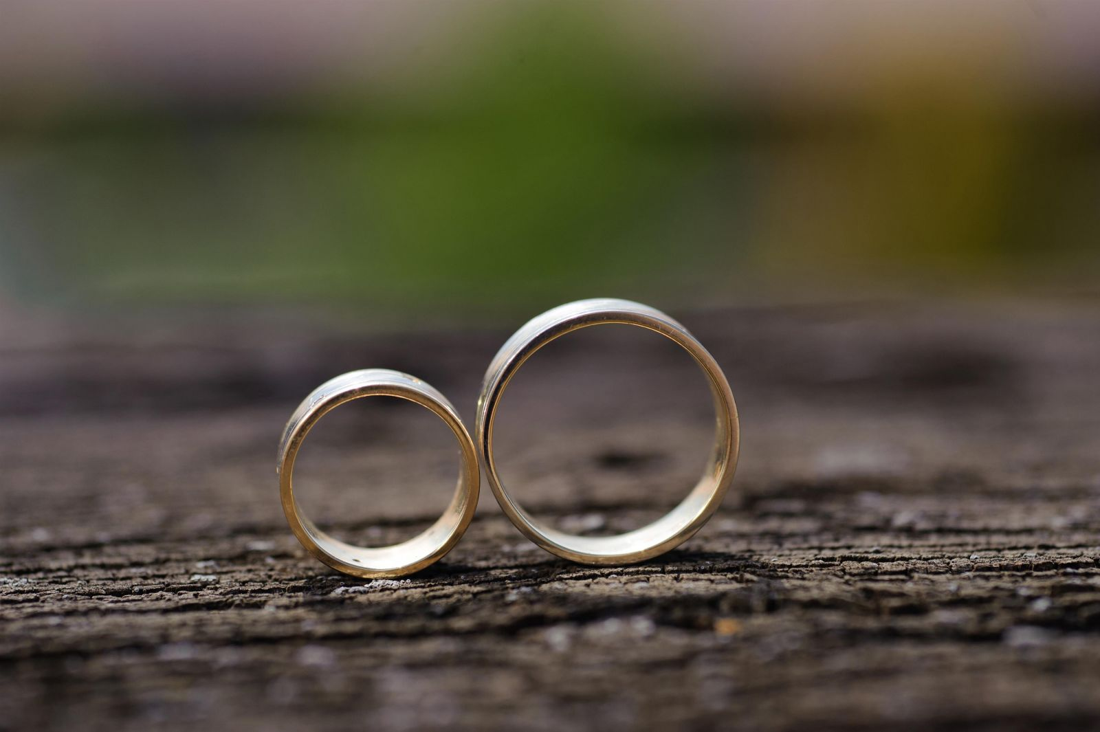 two wedding rings standing up